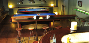 Playing pool at Café Salambó