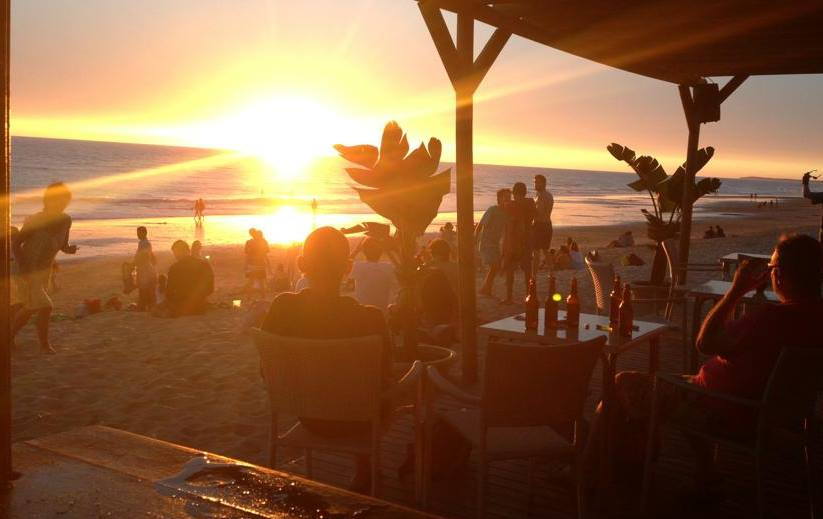 Sunset at a beach bar in Barcelona.