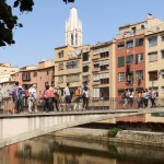 Onyar river in Girona with colourful houses and Sant Felix in the background