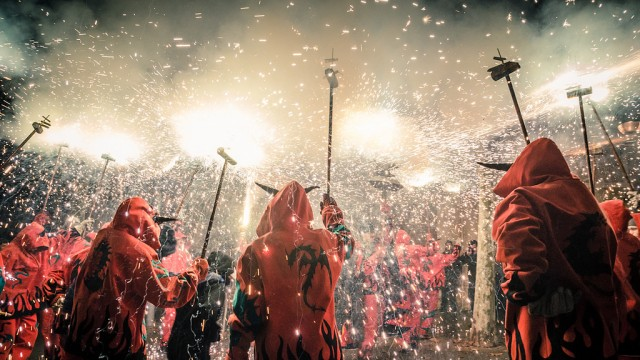 Smoke and sparkles fill the streets during a Correfoc