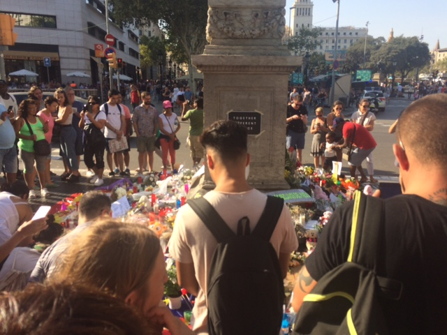 Locals and visitors giving flowers after the attack in Las Ramblas