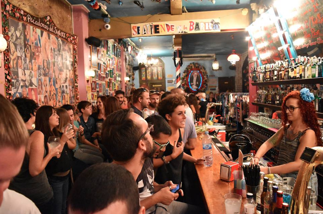 Customers ordering in a popular bar of Barcelona.
